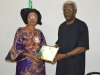 Dr. Victoria Enape conferring ICPC Chairman, Ekpo Nta with an honorary fellowship award by the Association of Forensic and Investigative Auditors (AFIA)