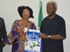 ICPC Chairman, Ekpo Nta presenting some of the Commission's publications to Dr. Victoria Enape