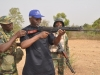 ICPC Chairman Barr Ekpo Nta firing at the shooting range