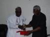 ICPC Chairman Ekpo Nta Presenting a Plaque to DG NOTAP Eng Umar Gimba