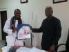 ICPC Chairman Ekpo Nta presenting some publications to Barr Ismaila Alasa, Chairman University of Ibadan Alumni Association, Abuja Branch