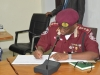 Corps Marshal of FRSC, Boboye Oyeyemi, MFR, mni, signing the visitors book.