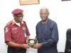 Corps Marshal of FRSC, Boboye Oyeyemi, presenting a plaque to ICPC Chairman, Mr. Ekpo Nta.