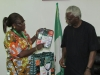 Director-General of NAFDAC Mrs. Yetunde Oni presenting some items to ICPC Chairman Mr. Ekpo Nta