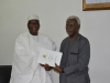 ICPC Chairman, Ekpo Nta presenting a Draft National Ethics and Integrity Policy to DG NOA, Dr. Garba Abari