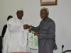 ICPC Chairman, Ekpo Nta receving some publications from DG NOA, Dr. Garba Abari