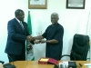 Executive Vice Chairman of NCC, Prof. Umar Danbatta, receiving a plaque from ICPC Chairman, Mr. Ekpo Nta