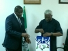 Executive Vice Chairman of NCC, Prof. Umar Danbatta, receiving some publications from ICPC Chairman, Mr. Ekpo Nta