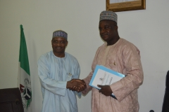 Ag. Chairman of ICPC, Dr. Musa Usman Abubakar receiving some publications from D-G NIMC, Engr. Aliyu Aziz Abubakar