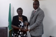 ICPC Acting chairman, Dr. Musa Usman Abubakar, presenting a commemorative plaque to Ms. Olajumoke Simplice during the courtesy visit