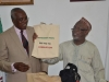 Hon. Bako Abdullahi presenting the Commission's publications to the ANAN President, Mr. Nzom