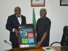 Chief Okoi Oboni-Obla presenting a framed poster to ICPC Chairman, Mr. Ekpo Nta