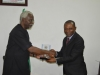 ICPC Chairman, Mr. Ekpo Nta presenting a commemorative plaque to the Auditor-General of the Federation, Mr. Anthony Mkpe Ayine during the courtesy visit