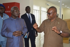 Secretary to the Commission, Dr. Elvis Oglafa (R) speaking with NACC Chairman, Rev. Massi Gams (L) during a tour of ICPC's training academy, the Anti-Corruption Academy of Nigeria (ACAN)