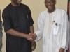 ICPC Chairman, Ekpo Nta in a handshake with Exec. Sec. NHIS, Prof.Yusuf Usman