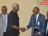ICPC Chairman, Ekpo Nta in a handshake with MD/CEO NSPM, Mr. Joseph Ugbo