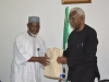 ICPC Chairman, Mr. Ekpo Nta presenting some of the Commission's IEC materials to Dr. Mohammed Sanusi