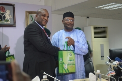 Acting Chairman ICPC, Dr. Musa Usman Abubakar receiving some publications of INEC from its Chairman, Prof. Mahmoud Yakubu