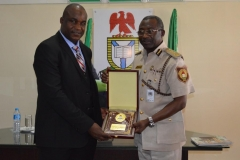 ICPC Acting Chairman, Dr. Musa Usman Abubakar [L], receiving a commemorative plaque from NIS Controller-General, Muhammed Babandede [R], during the courtesy visit
