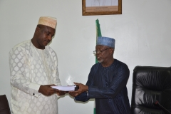 Alh. Bako Abdullahi, the out-gone Acting Chairman handing over to theSecretary to the Commission, Dr Musa Usman Abubakar