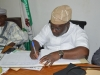 Hon. Babajide Akinloye signing the visitor's register