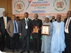 ICPC Chairman, Ekpo Nta (middle), holding his award and flanked by other dignitaries.