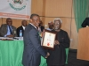 ICPC Chairman, Ekpo Nta, receiving the Award of Fellowship of the Institute of Corporate Administration from Dr. Godswill C. Onyekwere, Chief Learning Officer, ICAD Abuja