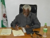 Out-going ICPC Chairman, Mr. Ekpo Nta signing handover documents during the ceremony.