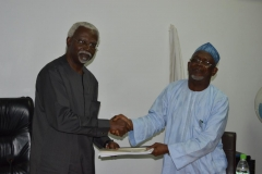 Out-going ICPC Chairman, Mr. Ekpo Nta, handing over to ICPC Acting Chairman, Alhaji Bako Abdullahi