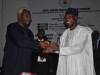 ICPC Chairman Ekpo Nta presenting a Plaque to Governor Osun State His Excellency Rauf Aregbesola