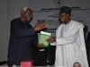 ICPC Chairman Ekpo Nta presenting a copy of ICPC Law Report to Governor Osun State His Excellency Rauf Aregbesola