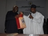 Governor Rauf Aregbesola presenting a Souvenir to ICPC Chairman Ekpo Nta