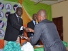 NAVC Coordinator, Mr. Mike Sowe presenting certificates to new members in Abia State