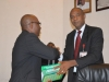 Mr. Okechukwu Igbudu presenting Mr Paul Erokoro (SAN) with the ICPC Law Report