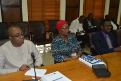 [L-R}: Prof. Sola Akinrinade, Provost, ACAN; Mrs. R.A. Okoduwa mni, Spokesperson for the Commission; Mr. Akeem Lawal, Head, CMED, during the presentation of the Anti-Corruption training materials at the ICPC headquarters in Abuja