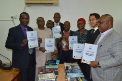 Secretary to the Commission, Dr. Elvis Ogalfa, UNODC officials and some top management staff displaying the Anti-Corruption training materials presented to ICPC's Academy by UNODC