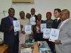 Secretary to the Commission, Dr. Elvis E. Oglafa, UNODC officials and some top management staff displaying the Anti-Corruption training materials presented to ICPC's Academy by UNODC.