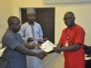 Mr Iroka Sampson, a senior official of the Anti-Corruption Academy of Nigeria ACAN presenting a certificate to one of the participants