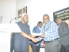 ICPC Chairman Mr. Ekpo Nta Presenting  certificate to one of the participants