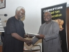 ICPC Chairman Mr. Ekpo Nta Presenting a certificate to one of the participants