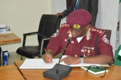 Corps Marshal of FRSC, Boboye Oyeyemi, signing the visitors` book.