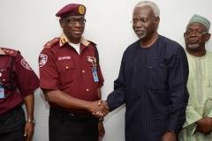 Corps Marshal of FRSC, Boboye Oyeyemi, in a warm handshake with ICPC Chairman, Mr. Ekpo Nta.