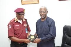 Corps Marshal of FRSC, Boboye Oyeyemi, presenting a plaque to ICPC Chairman, Mr. Ekpo Nta.