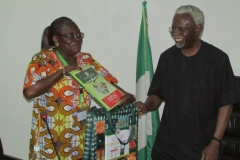 Director-General of NAFDAC Mrs. Yetunde Oni ,presenting some items to ICPC Chairman, Mr. Ekpo Nta