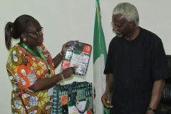 Director-General of NAFDAC Mrs. Yetunde Oni presenting some items to ICPC Chairman, Mr. Ekpo Nta