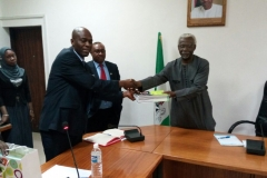 Alternate Chairman of NBA`s Anti-Corruption Commission, John Olusola Baiyeshea, SAN presenting a gift to ICPC Chairman, Mr. Ekpo Nta while Secretary to the Commission, Mr. Elvis Oglafa, looks on.