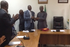 President of Quantity Surveyors Registration Board of Nigeria (QSRBN), Hussaini A. Dikko, Receiving a plaque from ICPC Chairman, Mr. Ekpo Nta
