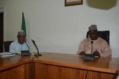 Director-General of NIMC, Engr. Aliyu Aziz Abubakar discussing with Acting Chairman of ICPC, Dr. Musa Usman Abubakar