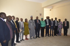 ICPC Acting Chairman, Dr. Musa Usman Abubakar in a group photograph with NSC officials and ICPC management staff