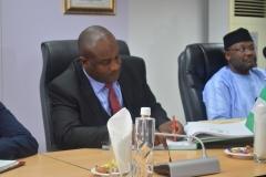 Acting Chairman ICPC, Dr. Musa Usman Abubakar signing the visitors register